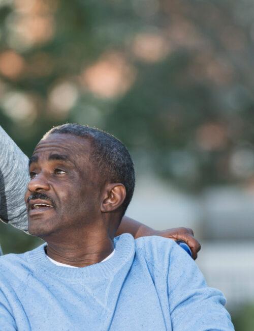 elder-african-american-couple-wqalking-in-park